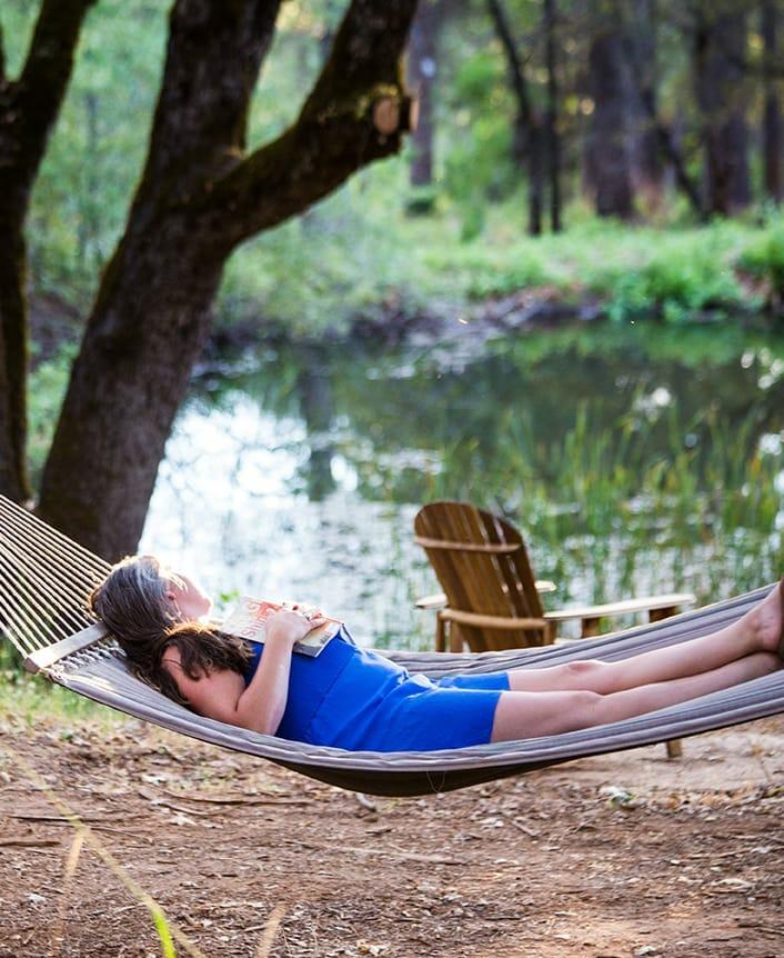 woman laying on a hammock