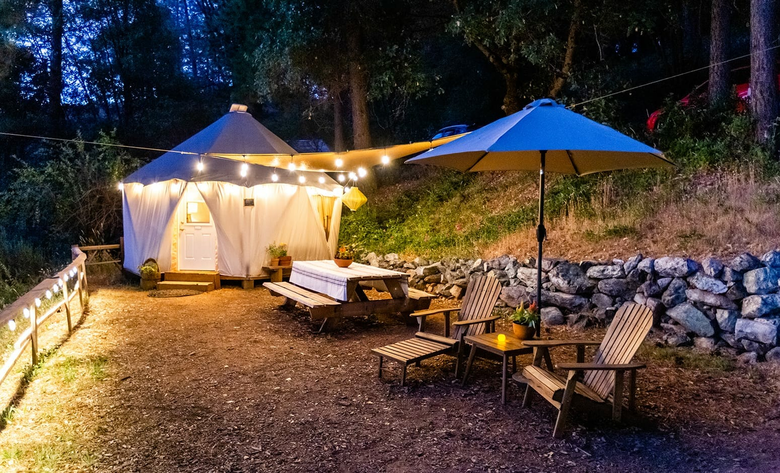 view of the garden outside the sunset yurt at night