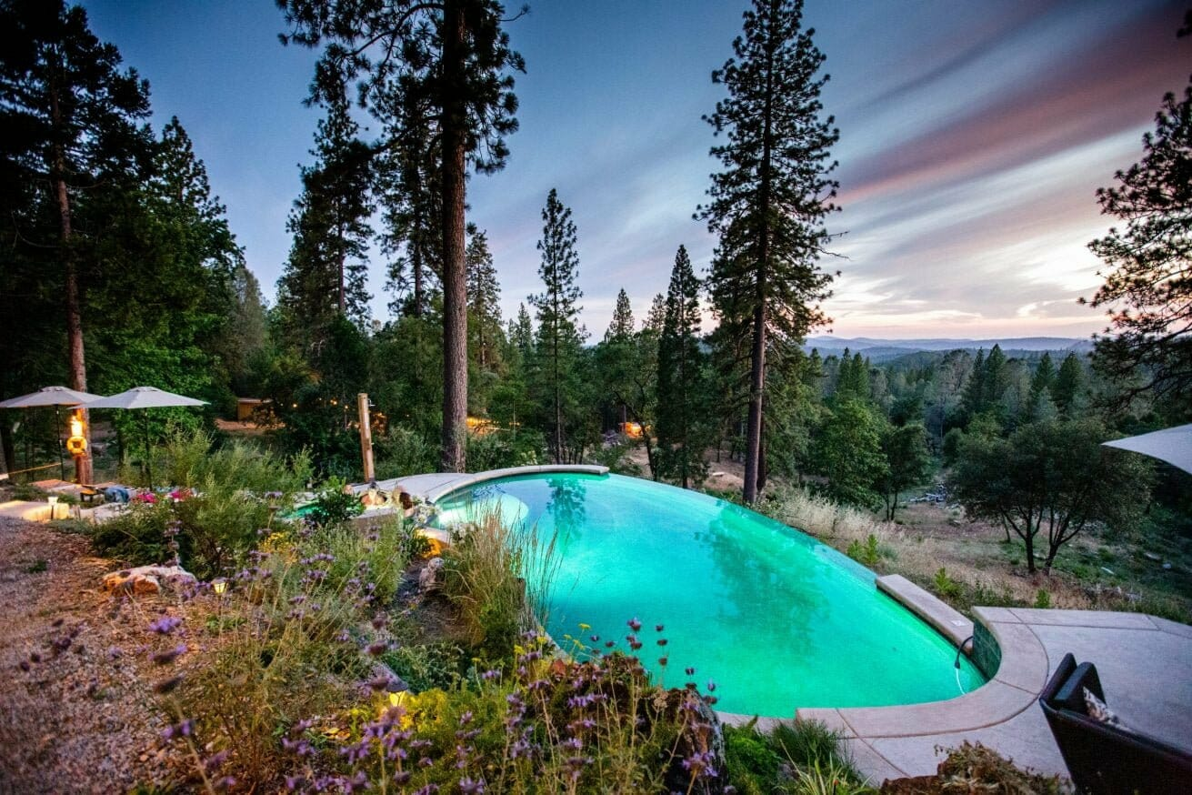Reverie retreat outdoor pool in the middle of the woods during the evening